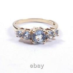 Aquamarine 5 stone ring 9 carat yellow gold