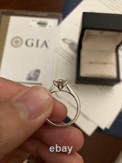 Blue Nile Diamond Ring. 76 carat RD F VS2