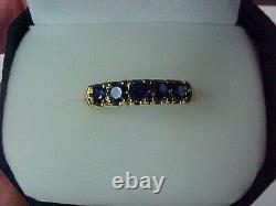 Ladies 14 Karat Kt Yellow Gold and Blue Sapphire Band Ring
