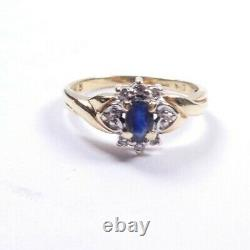 Sapphire and diamond cluster ring 9 carat yellow gold Size M